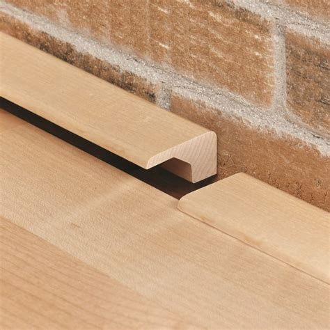 Hardwood Floor Trim Interior Design Detail Beige Wall Clean White Baseboard Molding Floor Molding In Uncategorized