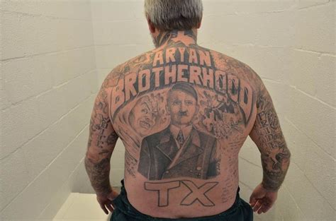 white supremacy tattoos suspected aryan brotherhood member charged with