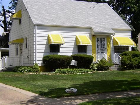 yellow color window awnings for a small cottage awnings
