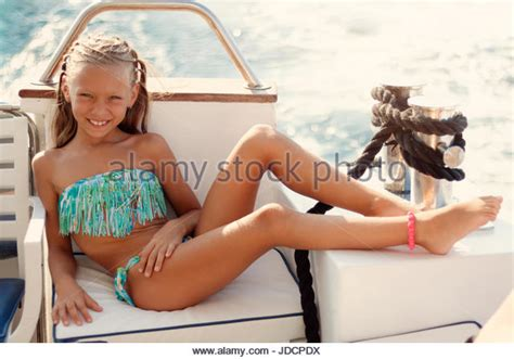 girl dancing on boat with kid girl sunbathing on deck boat stock photos girl