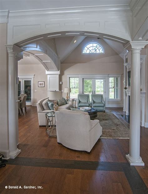 An Arched Entry Welcomes You Into This Soothing And Cozy Sagecrest House Plan