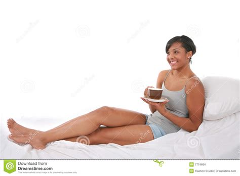 sitting in bed healthy looking female sitting in the bed stock images