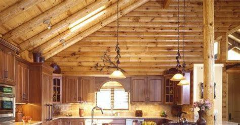 Log Cabin Ceilings by Cathedral Ceiling In A Log Home Log Home Kitchen With Cathedral Ceilings And Bar Log