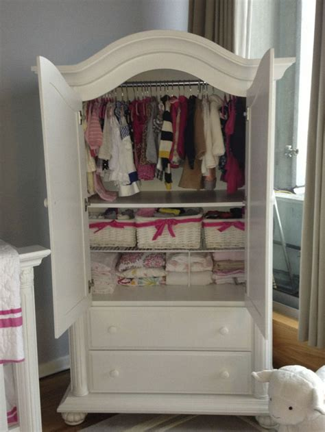 armoire for baby nursery no closet in the nursery so this baby cache armoire holds