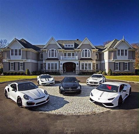 house with a massive 20 car garage for all of your toys is all my luxury sports cars parked in the driveway of our