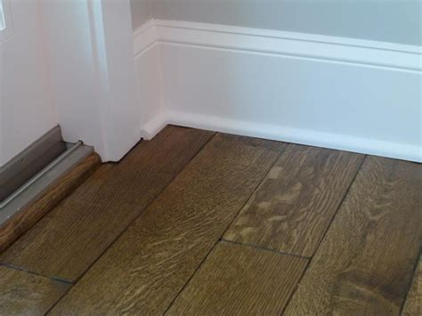 how to trim the base board with darker wood floors. Use
