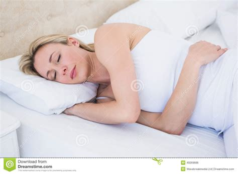 pretty in bed pretty sleeping in bed stock photo image 49269686