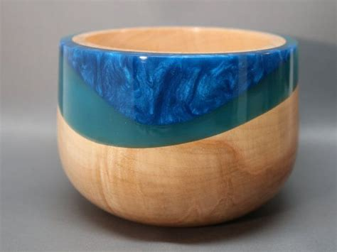 colored epoxy resin handmade wooden bowl made from maple and teal resin with