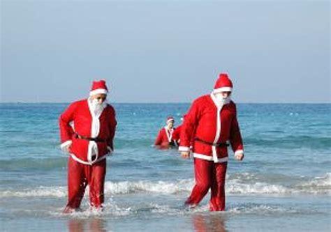 imagenes de santa claus en la playa santa claus en la playa descargar fotos gratis