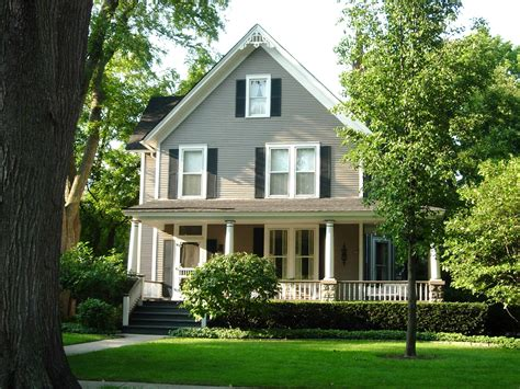 american farmhouse style another lovely exle of american farmhouse style different sized 2nd story windows plus