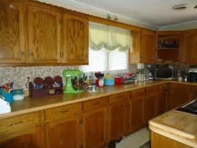 how do i design my kitchen should i paint my custom solid wood kitchen cabinets