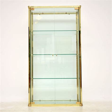 brass and glass display cabinet 1970 s vintage brass glass display cabinet