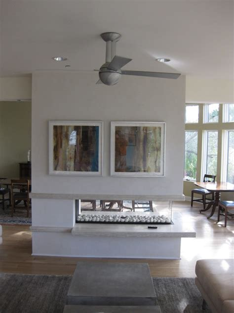 open three sided gas fireplace with floating hearth