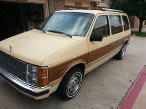 curbside classic 1985 dodge caravan chrysler hits a