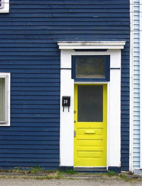 blue house yellow door dark blue house white trim and yellow door