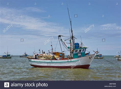 very small fishing boats fishermen in a very small boat stock photos fishermen in