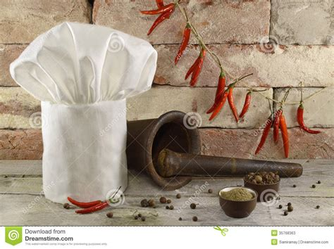 Cooks Whole White Pepper toque with kitchen ware and peppers stock image image