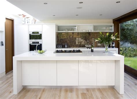 white kitchen laminate flooring white laminate flooring spaces modern with view