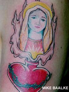 tattooed heart vevo sacred heart and mary tattoo tattooimages biz