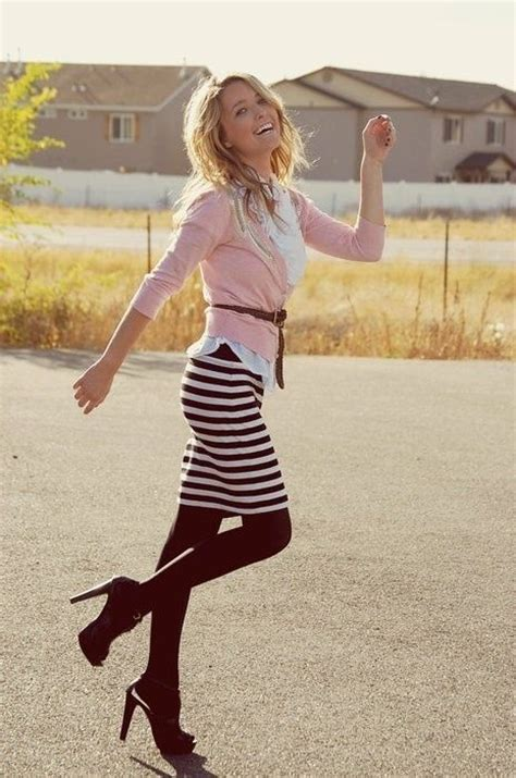black and brown patterned tights white blouse pink cardigan with brown belt striped skirt