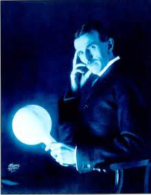 Tesla Experiments For Nikola Tesla Holding A Gas Filled Phosphor Coated Light
