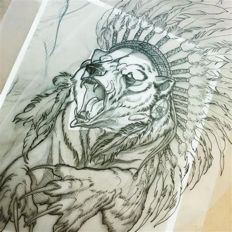 sharp nailed bear in indian leader feathered hat tattoo