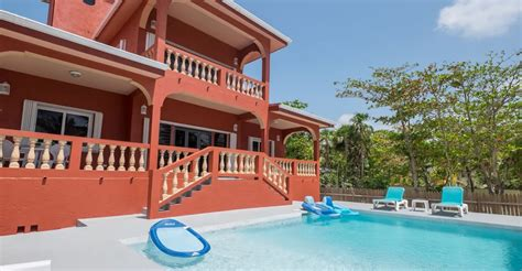 2 bedroom beachfront villa for sale ambergris caye