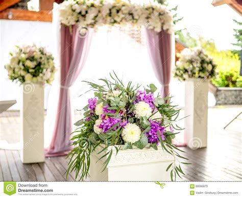 Wedding Arch Curtains by Flower Decoration On Background Of Wedding Arch Stock