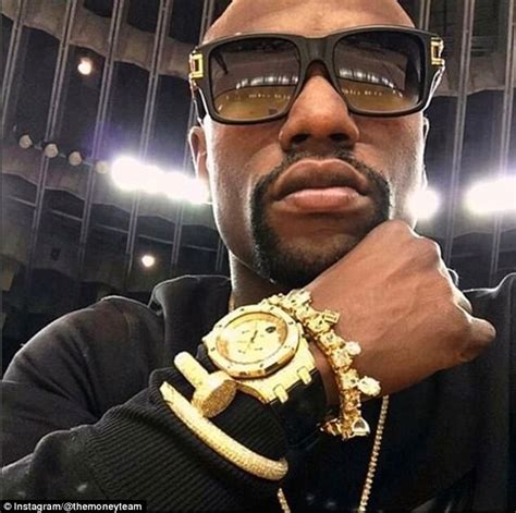 floyd mayweather shows bling as conor mcgregor fight nears