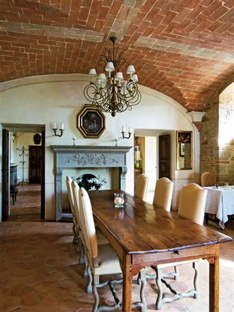 spectacular dining room with farmhouse table and brick