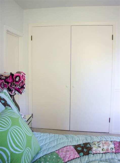 closet door diy makeover with molding and bulletin boards