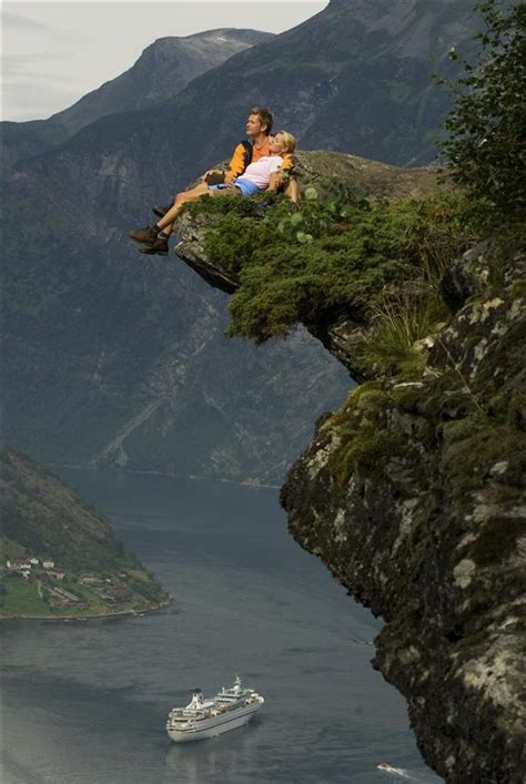 fjord jobs on a cliff over geirangerfjord more and romsdal west norway