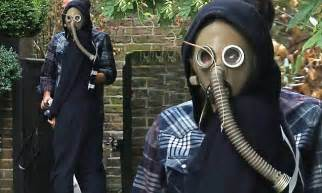 delevingne covers  face  gas mask   attempt