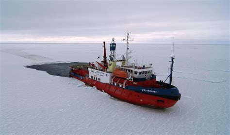 sinking boat icebreaker ship trapped in antarctic awaits rescue