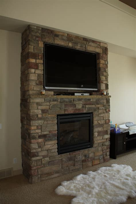 tv above fireplace nice fireplaces with tv 11 stone fireplace with tv above