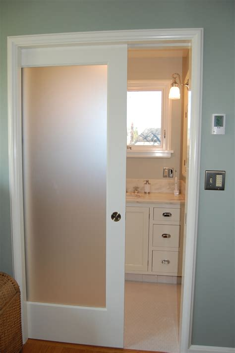 Small and narrow modern minimalist bathroom closet design with single sliding frosted glass door