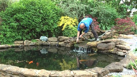 Small Backyard Pond Cleaning A Koi Pond Waterfall In The Midlands Uk By Any