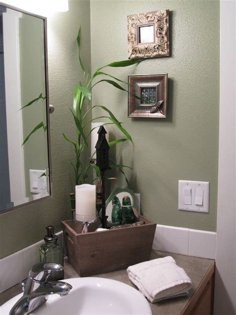 spa like feel in the guest bathroom the fresh green color makes the narrow room feel