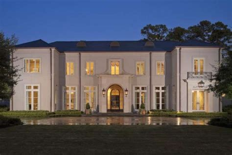 neo classical homes a large driveway leads to the front of the home rudy