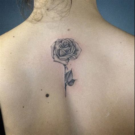 rose tattoo on back back of a artist