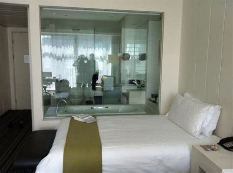 glass wall between bedroom and bathroom transparent glass wall with electric curtain separates the
