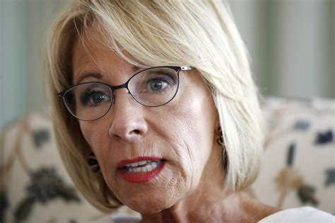 betsy devos in atlanta ap interview devos says she didn t decry racism enough