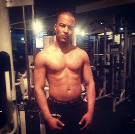 a shirtless t i shows off his muscles bossip