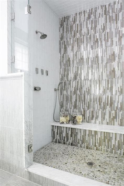 vertical subway in grey yummy rental bathroom pinterest gray and taupe glass shower tiles with marble shower bench
