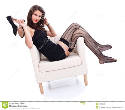 woman in armchair sexy woman in armchair royalty free stock images image