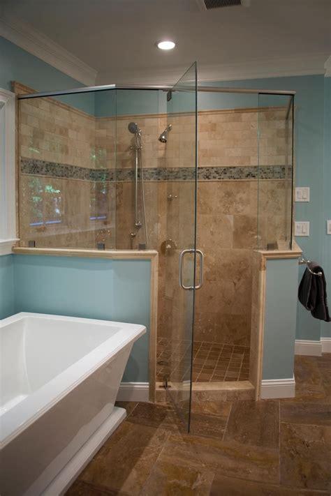 light blue master bathroom features  spacious glass