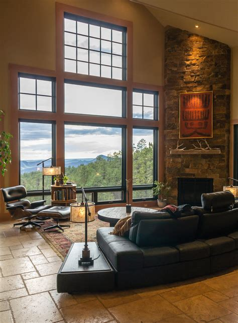 neutral transitional family room with curved sofa and transitional l living room rustic with picture window