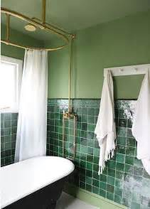 contemporary bathroom with green wall and green tiles