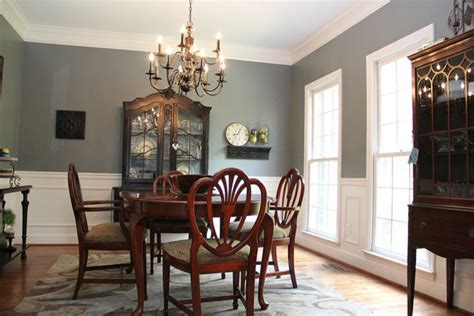 smoky blue dining room with brown and black accents eclectic dining room birmingham by
