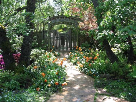 Entrance garden ideas landscape beach style with climbing plants white arbor garden entrance